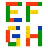 Conjunto del alfabeto hecho de bloques del ladrillo de la construcción del juguete ilustración del vector
