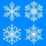 Conjunto del invierno del copo de nieve Siluetas del vector en fondo azul ilustración del vector