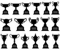 Conjunto del negro de la silueta de la taza del trofeo Foto de archivo libre de regalías