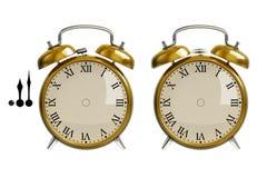 Conjunto del reloj de alarma del oro imágenes de archivo libres de regalías