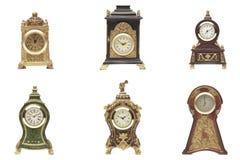 Conjunto del reloj en el fondo blanco Fotos de archivo