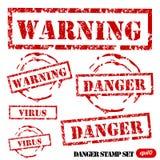 Conjunto del sello del peligro de Grunge Foto de archivo libre de regalías