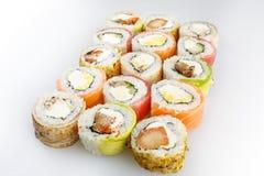 Conjunto del sushi Rolls con los salmones y las verduras Foto de archivo libre de regalías