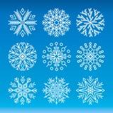 Conjunto del vector de copos de nieve ilustración del vector