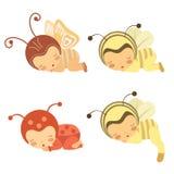 Conjunto lindo de bebés durmientes en varios trajes Imágenes de archivo libres de regalías