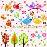 conjunto Pájaros, árboles y flores Fotos de archivo