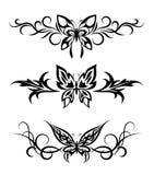 Conjunto tribal con las mariposas, tatuaje Fotografía de archivo