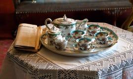 Conjunto y papel finos de té de China Imagen de archivo libre de regalías