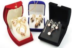 Conjuntos del oro de la joyería Foto de archivo libre de regalías