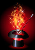 Conjurer hat with blazing red fire. Conjurer hat with magic wand and blazing red fire Stock Photo