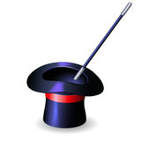 Conjurer hat and magic wand Royalty Free Stock Photos