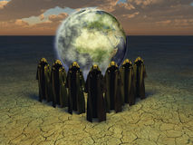 The conjurer priests. Hooded caped figures and the earth Stock Image