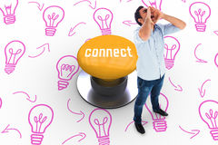Connect against yellow push button Stock Photography