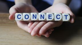 Connect. Cube letters about connecting relationships, having the ability and skills to connect with people on palms of hand stock image