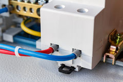 Connect electrical socket on the DIN rail closeup Royalty Free Stock Image