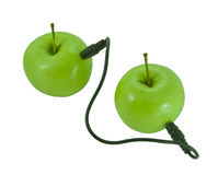 Connect'em all. Two apples connected via cable with two jacks in each end Stock Photo
