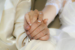 Connect fate. The couple holding hands on their wedding day Stock Image
