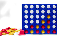 Connect four in a row family game. With yellow and red game pieces showing a row completed stock photography