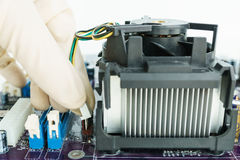 Connect heat-sink connector on board Stock Photos