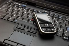 Connect. Laptop and smartphone. Keyboard of high-end laptop and modern smartphone on it. RAW and Tiff also available on demand Stock Photography