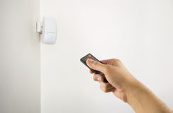 Connect the motion detector Stock Photo
