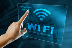 Connect to a free wi fi zone on a smart phone. Woman's Hand log in to a free WI-FI zone on a digital screen royalty free stock photography