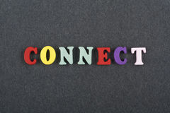 CONNECT word on black board background composed from colorful abc alphabet block wooden letters, copy space for ad text Royalty Free Stock Image