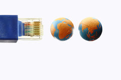 Connect the world. An image of a RJ45 with two globe showing the continent of Asia & Africa stock photography