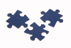 Connected 2. Three separated pieces of a jig saw puzzle, isolated on white Royalty Free Stock Photography