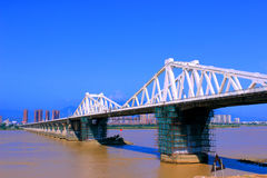 Connected on both sides of the bridge. Urban landscape, broad rivers, turbid water, connected on both sides of the bridge, the blue sky Stock Photo