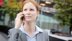 Connected Businesswoman in a City Stock Photo