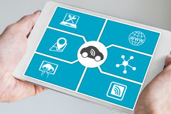 Connected car and digital mobility concept. Hand holding tablet. Stock Images