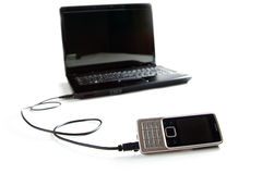 Connected cellphone to laptop Stock Photography