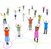 Connected Children with Their Arms Raised Stock Photography