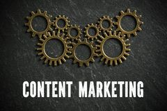 Connected cogwheels with the words `content marketing` stock image