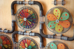Connected fans and blades. These colorful fans demonstrate fractions and complementary colors in a fun learning display Royalty Free Stock Photography