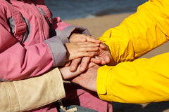 Connected hands of family as support sign Royalty Free Stock Photo