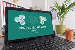 Connected health concept on a laptop. Laptop screen with connected health concept stock images