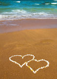 Connected hearts on beach - love concept Royalty Free Stock Photos