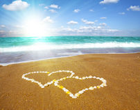 Connected hearts on beach - love concept Royalty Free Stock Photography