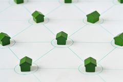 Miniature houses connected - House sharing concept. Connected miniature houses. House sharing concept royalty free stock photography