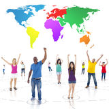 Connected Multi-Ethnic People Arms Raised and Colorful World Abo. Ve Royalty Free Stock Photos