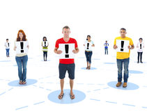 Connected Multiethnic People Holding an Exclamation Mark.  royalty free stock photos
