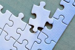 Connected pieces of one-color puzzle. Closeup. royalty free stock image