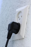 Connected power cord. A connected power cord: using electricity from the power net stock photos