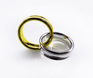 Connected shiny gold & silver ring. Two interconnected golden and silver (or titanium) rings. For engagement, wedding or anniversary. Metaphor for lovers Royalty Free Stock Photo