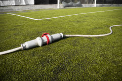 Connected stadium. Connected wire in a soccer field on grass Royalty Free Stock Photos