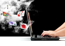 Connected to the Cloud. A female hands typing on a laptop with a cloud and some flying pictures Royalty Free Stock Images