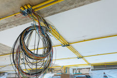 Connected to power lines, cables and pipes, PVC Wall Building Ma royalty free stock images