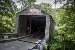 Connecticut Covered Bridge. An old covered bridge along highway 7 in Connecticutt surrounded by trees Royalty Free Stock Photography